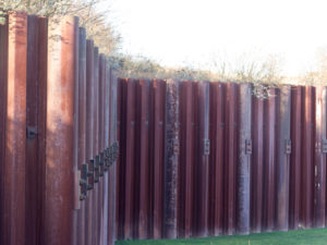 Parallel seismic surveys measure the depth of sheet piles and foundations.